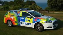 Sussex Police car in Pride livery